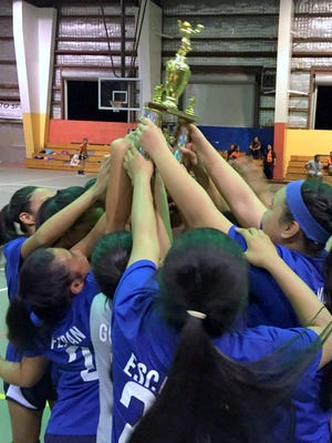 The Vicente S.A. Benavente Roadrunners won the 2015 Guam Interscholastic Sports Association middle school girls' volleyball league title with a 14-0 record