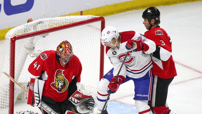 Montreal Canadiens right wing Dale Weise (22) shots on Ottawa Senators goalie Craig Anderson (41) as defenseman Marc Methot (3) defends during an over time period in game three of the first round of the 2015 Stanley Cup Playoffs at Canadian Tire Centre.