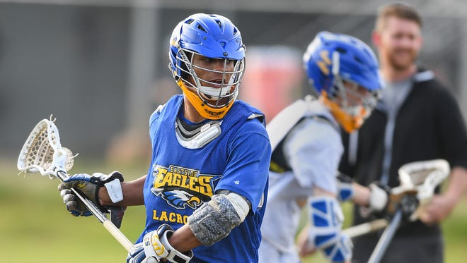 Eastside senior Ian Rodgers, who is a three-sport athlete, practice with the lacrosse team at the school on Wednesday, April 19, 2017.