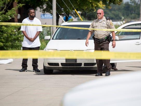 Emergency responders secure the scene of a shooting
