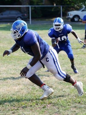 Carteret's Sam Kamara works out during pre-season football practice, Monday, August 17, 2015, in Carteret, NJ.