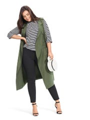 Striped T-shirt, $22.99; trench  vest, $44.99; skinny cropped pants, $32.99.