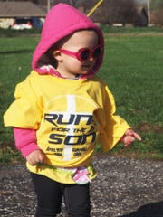 Olivia Rush took advantage of the spring festival and Easter egg hunt at last year's Run for the Son.