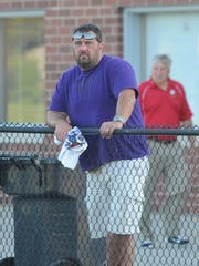 Hagerstown head football coach Scott Snodgrass watches the Indiana Football Hall of Fame East West All-Star Classic at Anderson High School Friday, June 17, 2016.