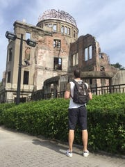 Anthony Bass observes the A-Bomb memorial in Hiroshima.