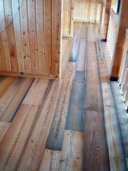 """A Flathead Lake larch floor of """"character grade"""" in a mountain cabin in northern Idaho. The customer wanted to maximize the color variations and the diversity of the wood so they didn't mind some splits, cracks and knots."""