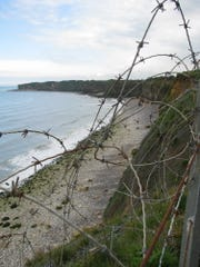 View of portion of Omaha Beach from atop 90-foot cliffs of Pointe du Hoc where Germans had placed large artillery pieces.  On D-day, Pointe Du Hoc was attacked by U.S. Army rangers who climbed up the cliffs by using rope ladders, only to find that the Germans had moved the large artillery pieces farther inland.  Of the more than 200 Army rangers who landed at the base of the cliffs, less than 70 were still able to fight after three days of attacking the cliffs and holding off German counter-attacks.