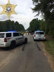 Natchitoches Parish Sheriff's deputies and detectives work a scene on Grappers Bluff Road where a body was found underneath a bridge. An autopsy will be conducted to determine the cause of death.