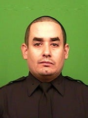 This photo provided by the New York Police Department shows officer Rafael Ramos.