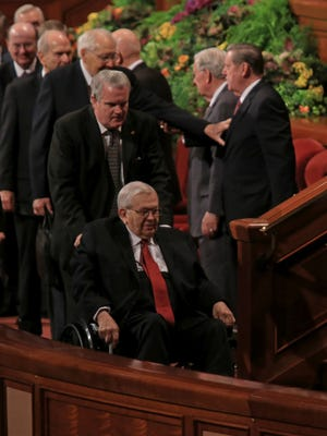 President Boyd K. Packer, in the wheelchair, is pictured at the 184th Semiannual General Conference of The Church of Jesus Christ of Latter-day Saints in Salt Lake City in 2014.