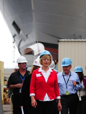 Sen. Tammy Baldwin gets a briefing and tour of the Navy shipbuilding program in August at Marinette Marine Corp.