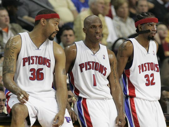FILE - Detroit Pistons, from left, forward Rasheed Wallace, guard Chauncey Billups and guard Richard Hamilton wait on the sidelines April 23, 2006.