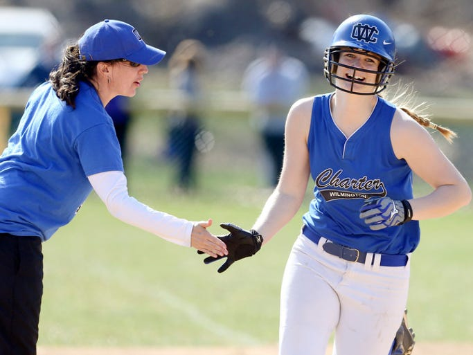 Charter head coach Eileen Voltz congratulates Jordan Schoeneberger after her third inning home run in Charter's 8-1 win over Padua, Thursday, April 10, 2014 at the Midway Softball Complex.
