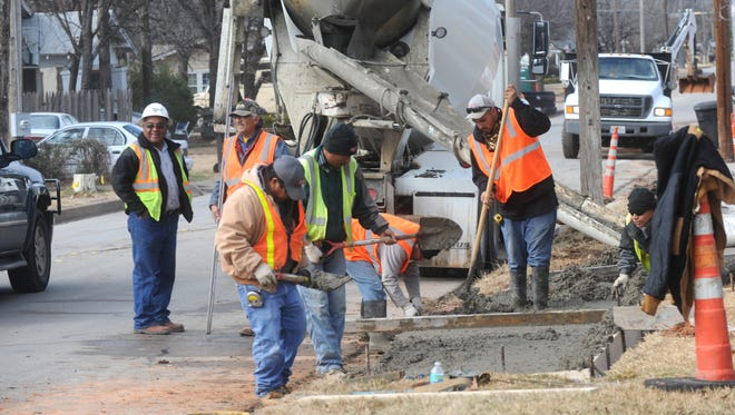 Construction workers were able to make progress on a sidewalk along South 11th Street, near Stowe Street, before rains set in Tuesday afternoon. The National Weather Service recorded 0.35 of an inch of rain through 6 p.m. Tuesday. Warmer temperatures are expected Wednesday through Friday before another chance of rain pops into the forecast on Friday. Wednesday's high is expected to be 58 degrees.