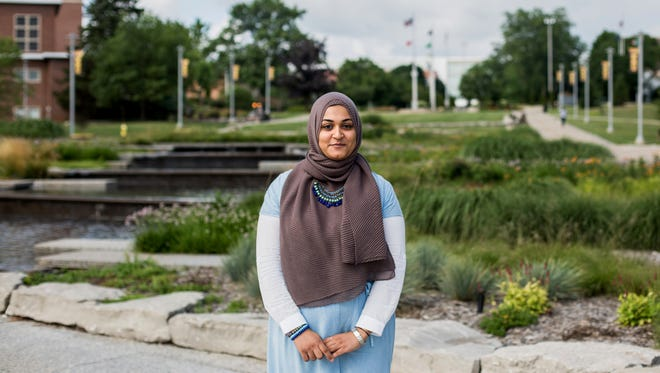 Amal Mohamed, 22, a graduate student at Western Michigan University poses for a portrait on the campus in Kalamazoo, Mich. on Friday, July 14, 2017.  Mohamed is working towards her master's degree in social work.