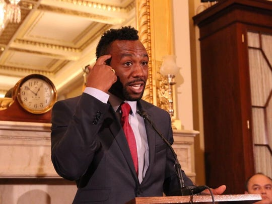 Boxer Austin Trout speaks from the podium of an Capitol