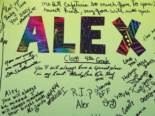 A board signed by students and staff at Mount Auburn