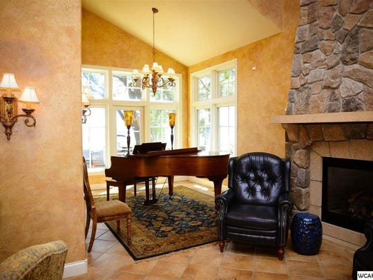 The lake property at 13931 Skyline Drive in Spicer has room for a grand piano.