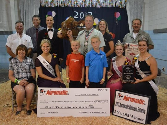 Pictured are first-place winners in the 2-year-old class, front row, from left: Mary Ryan, owner; Crystal Seimers-Peterman, 2017 Alice in Dairyland; Dylan and Cameron Ryan, owners; Courtney Moser, 2017 Wisconsin Holstein Association Princess; and Kati Kindschuh, 2017 Fond du Lac County Fairest of the Fair; back row: Mark Ryan, owner; Jeff Liner; Jerome Meyer, Judge; Ryan-Vu Armani Design-Red; Chad and Amy Ryan, owner; and Steve Kamphuis.