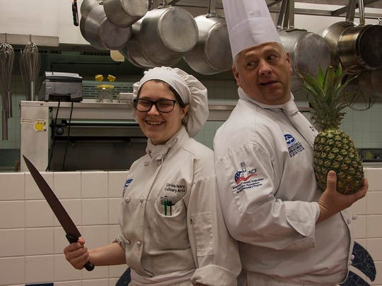 Corina Henry, left, with Chef Robert Corle.
