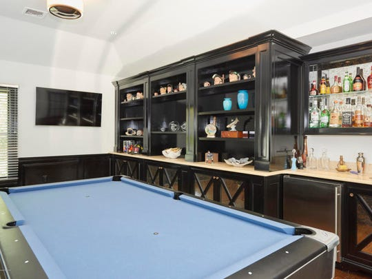The estate offers a billiard room with a custom built wet bar.