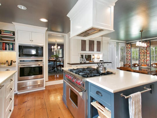The kitchen features stainless steel appliances and updated quartz countertops.