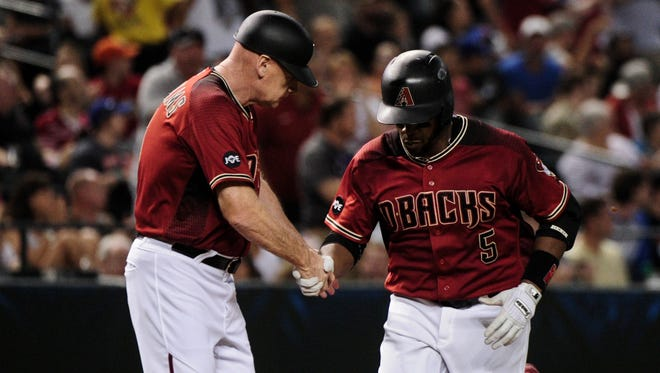 Arizona Diamondbacks left fielder Rickie Weeks (5) celebrates with third base coach Matt Williams (9) after hitting a three-run home run in the fifth inning against the New York Mets at Chase Field on August 17, 2016.