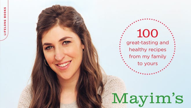"""In her latest book, """"Mayim's Vegan Table,"""" actress Mayim Bialik gives parents the basics of making kid-friendly recipes that are entirely free of meat and animal products."""
