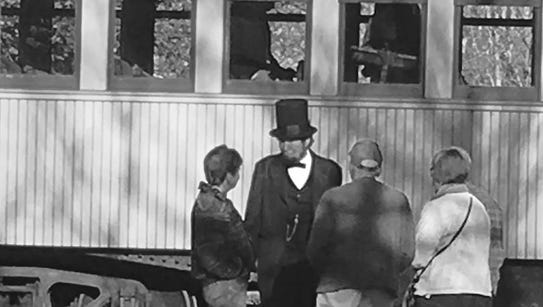 A re-enactor portrayed Abraham Lincoln at a recent