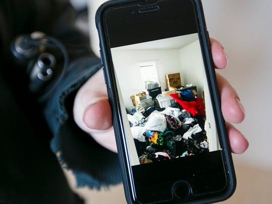 Jason Lindial shows a picture of a bedroom that was tossed with clothes and other items after burglars broke in and stole several items, including his laptop and heirloom jewelry belong to his partner Jetzabel Franco. The two had just moved into the house when it was burglarized.