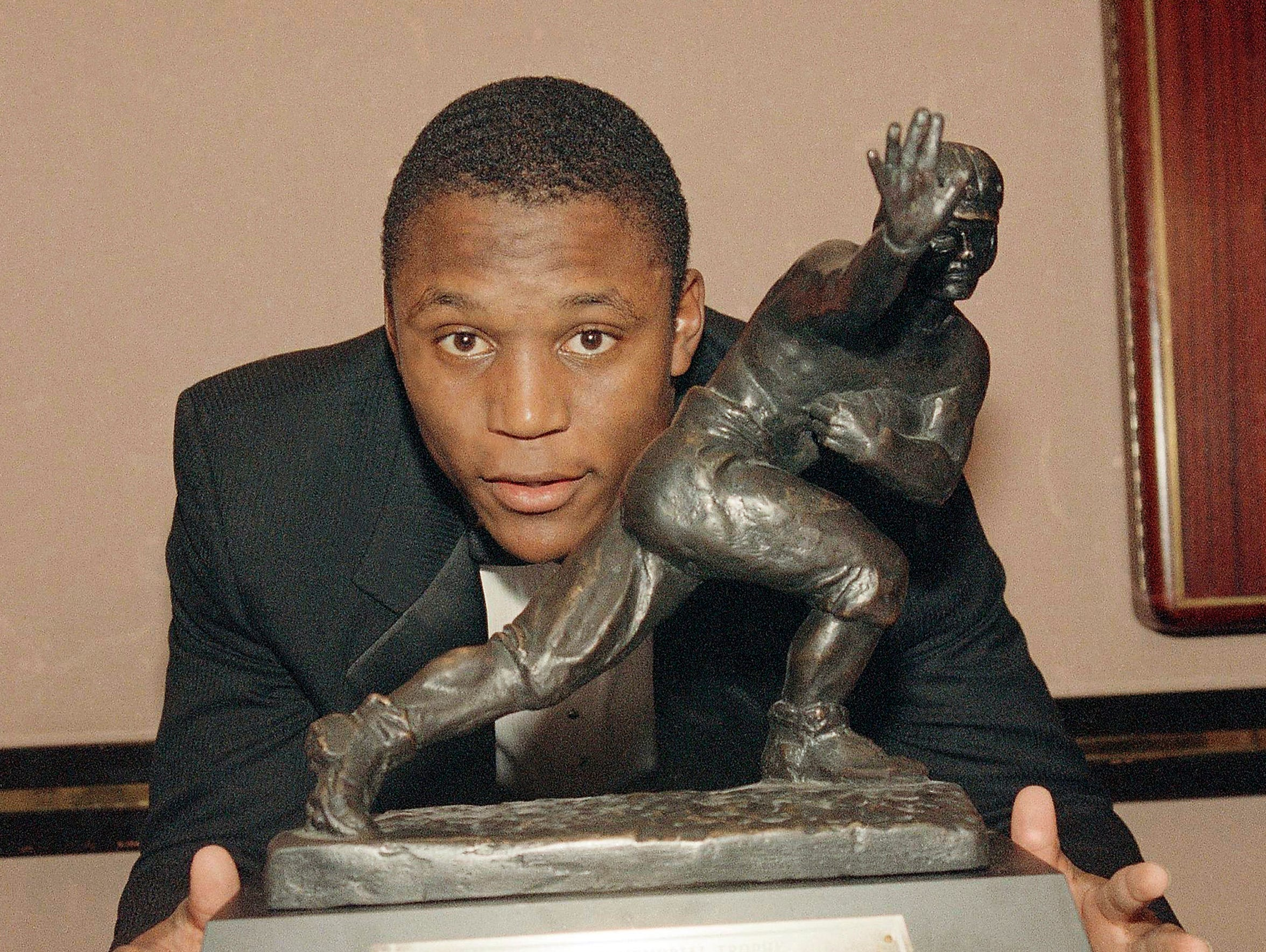 Oklahoma State running back Barry Sanders poses with