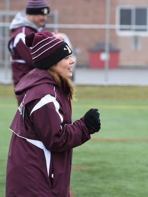 Arlington High School junior varsity girls lacrosse coach Jaclyn Murphy cheers on her team during Saturday's opening game at home against Monroe-Woodbury.
