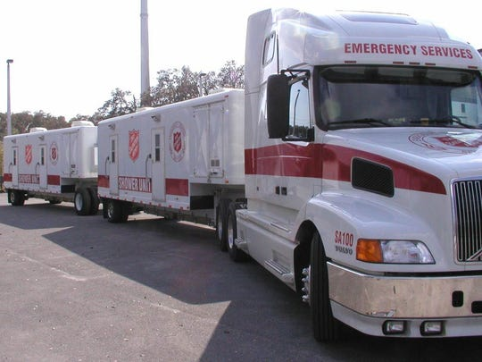 Salvation Army mobile shower units leave from Florida for Texas as part of Hurricane Harvey recovery efforts.