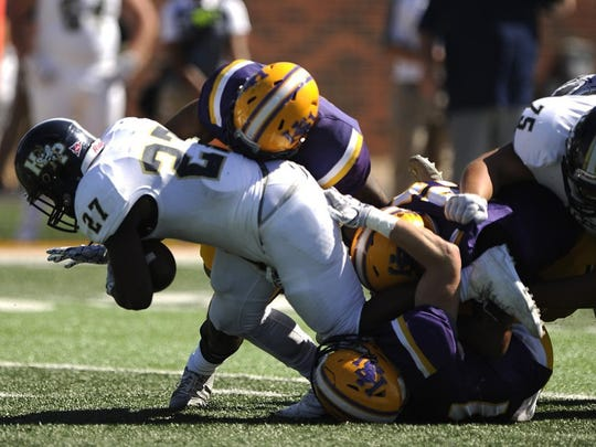 Thomas Metthe/Reporter-News Hardin-Simmons linebacker Josh White (31) tackles Howard Payne running back Shannon Warren (27) for a loss during the first quarter of the Cowboys' 54-15 win on Saturday, Oct. 15, 2016, at HSU's Shelton Stadium.