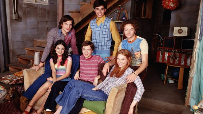The 'That 70s Show' cast poses in the now-distant '90s, when the comedy became a hit for Fox.