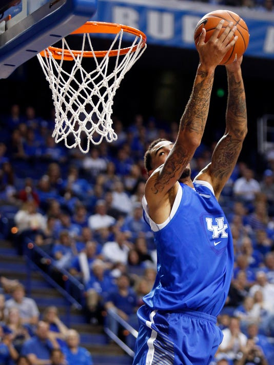 The Blue squads' Willie Cauley-Stein dunks during Kentucky's intrasquad NCAA college basketball scrimmage, Monday, Oct. 27, 2014, in Lexington, Ky. (AP Photo/James Crisp)