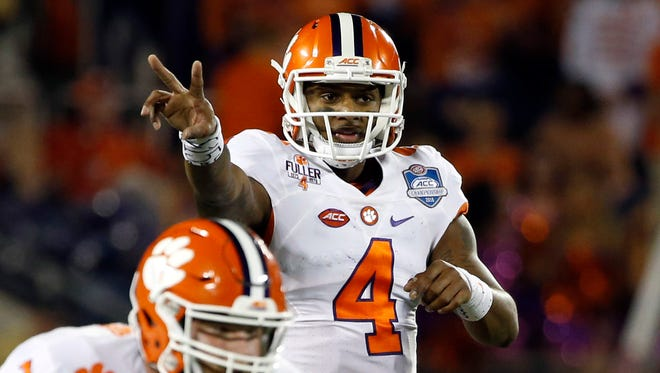 Dec 3, 2016; Orlando, FL, USA; Clemson Tigers quarterback Deshaun Watson (4) calls a play against the Virginia Tech Hokies during the first half of the ACC Championship college football game at Camping World Stadium. Mandatory Credit: Kim Klement-USA TODAY Sports