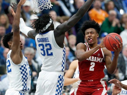 Alabama's Collin Sexton (2) heads to the basket as