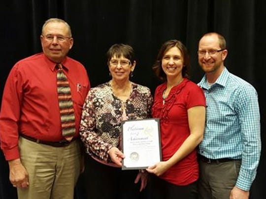 Vision-Aire Farms, owned by the Grade family, Eldorado, was recently honored as one of the top six farms in the nation for their milk quality. Accepting the award in Arizona are, from left, Roger and Sandy Grade, their daughter, Janet (Grade) Clark, and her husband, Travis Clark.