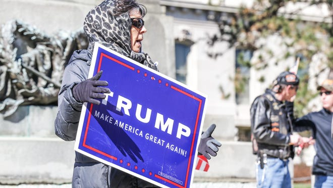 A women who declined to be identified chants during the March 4 Trump rally in Indianapolis. Thirty five to forty Trump supporters marched from Monument Circle to the Indiana Statehouse.