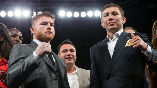 FILE - In this May 6, 2017, file photo, Canelo Alvarez, left, and Gennady Golovkin pose in Las Vegas. Alvarez against Golovkin is as good as it gets in the Sweet Science, a sport that is in the midst of a renaissance of sorts. They meet Saturday night, Sept. 16, 2017, in a middleweight title clash as highly anticipated by boxing purists as was McGregor's challenge of Mayweather to UFC fans. (Erik Verduzco/Las Vegas Review-Journal via AP, File)/Las Vegas Review-Journal via AP)