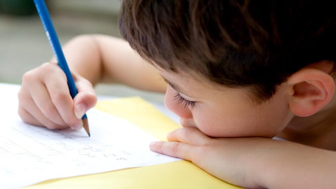 Writing an old-fashioned letter by hand is one way children can stay connected with their friends during the coronavirus pandemic.