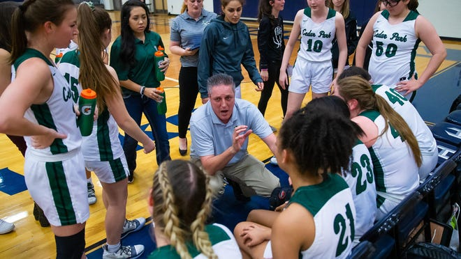 Cedar Park girls basketball coach Donny Ott talks to his players during a playoff game against Hutto. A district title and a long playoff run helped the Timberwolves win the 2020 Breazeale Cup.