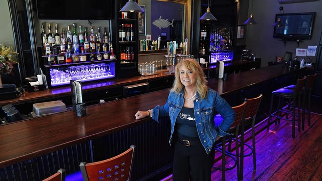 Dora Hand, owner of Hagan's Grill in Hampton, at her newly redesigned bar on High Street.