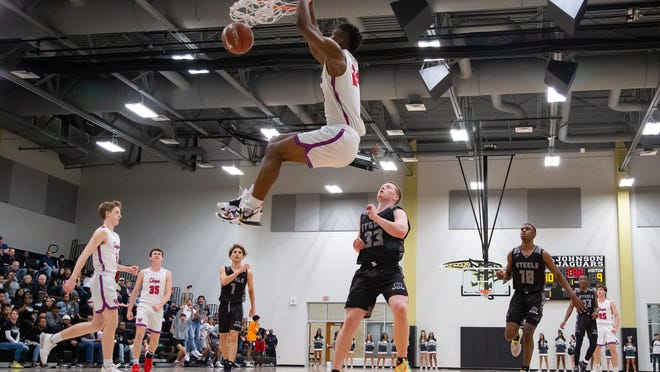 Westlake forward KJ Adams completes a slam dunk against Cibolo Steele in February. The Chaparrals star committed to Big 12 power Kansas on Friday.