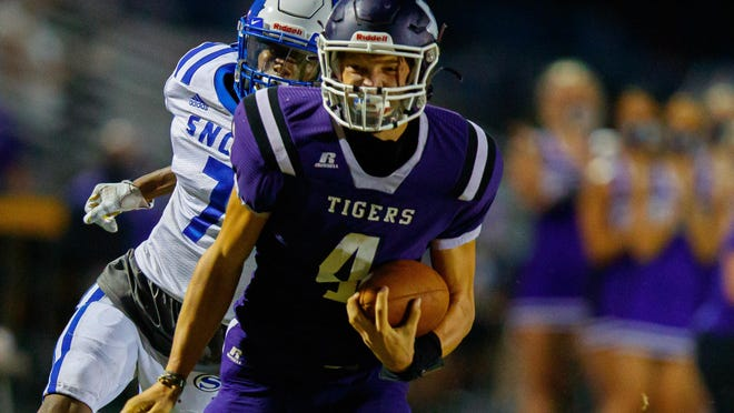 Thrall running back Dallas Meiske runs the ball after a reception while being chased by Snook defensive back Deshun Hamilton during the Tigers' 26-20 win Friday. It was Thrall's first victory of the season.