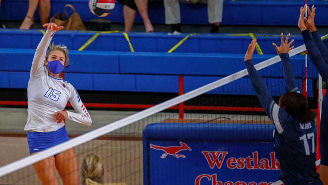 Westlake's Katie Hashman hits cross court during the Chaparrals' nondistrict win over Smithson Valley Saturday. Hashman totaled 14 kills in the contest.
