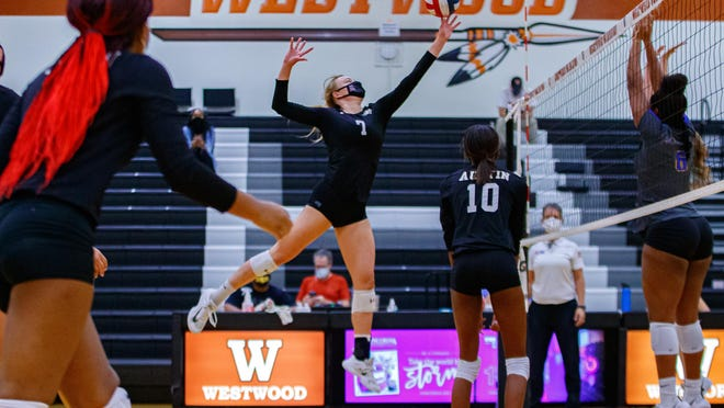 Austin High outside hitter Brooke Jeffrey, leaping for a shot against Pflugerville last week, had 31 total kills as the Maroons opened the season 3-0.