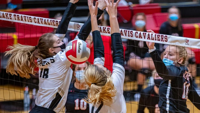 Lake Travis hitter Liliana Mechura, right, taps a shot over the Vandegrift block at a nondistrict contest Saturday at Lake Travis High School.