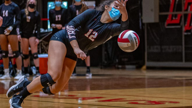 Lake Travis outside hitter Arden Besecker dives for a shot in the Cavs' win over  Vandegrift Saturday at Lake Travis High School. Besecker, a junior who has committed to Florida State to play beach volleyball, returns after an all-district season.